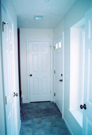 Looking From The Mechanical Room, The Foyer Closet Is Directly Ahead, With  The Door To The First Floor Half Bath On The Left. The Mechanical Room  Contains ...